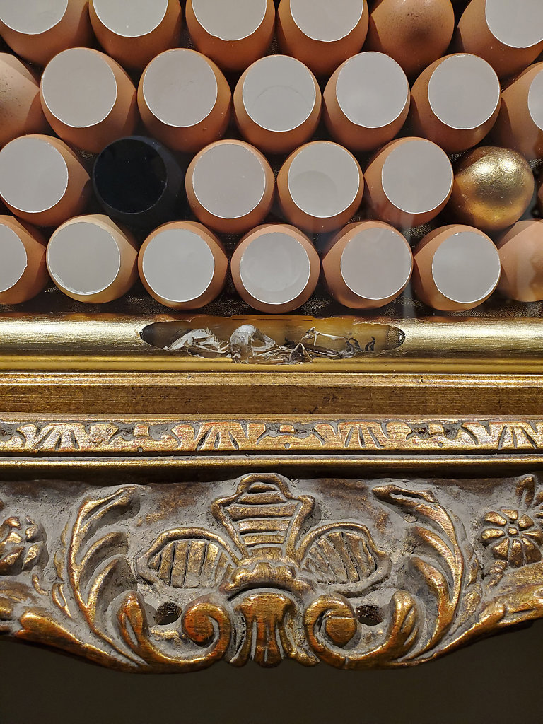 Frame detail showing gold leaf ossuary below the eggs.