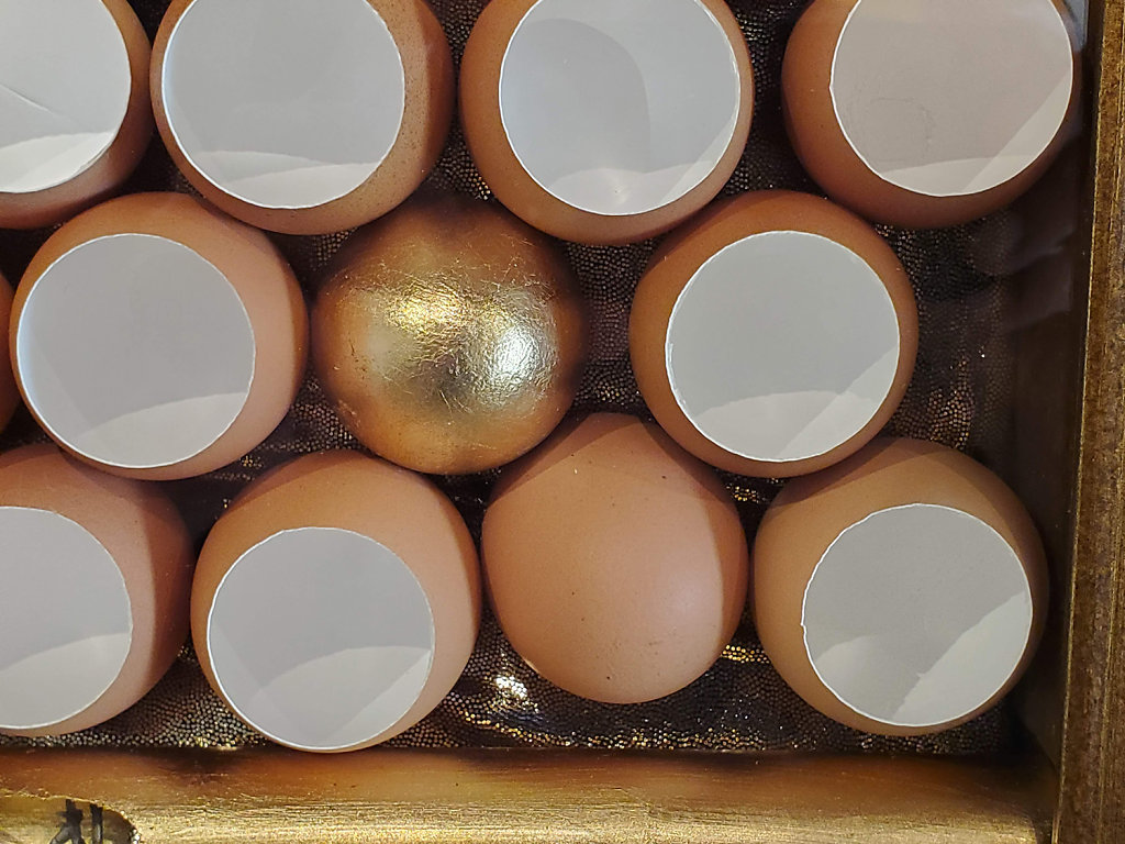 Egg treatment with gold leaf